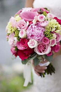 All pink and green wedding bouquet.  Green hydrangea,  pink peonies, pink mini Callas, pink spray roses.