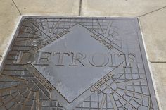 Plaque in sidewalk showing the different names of Detroit.