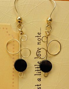 Deco Earrings with Black Agate. i have purple resin discs in the same shape...