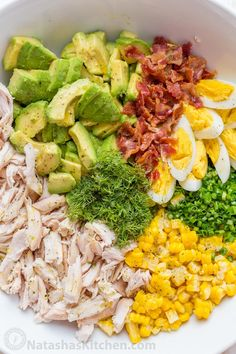 This Avocado Chicken Salad recipe is a keeper! Easy, excellent chicken salad with lemon dressing, plenty of avocado, irresistible bites of bacon and corn   natashaskitchen.com