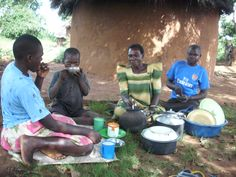 """Read our blog series on school nutrition & the awesome sweet potato, then send pics of your """"colorful"""" meal: http://childempowerment.tumblr.com/ CEI Uganda photo: A student shares a meal with his family"""