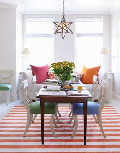 colorful contemporary kitchen. striped rug, mismatched upholstery, and white | Todd Klein.