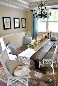 Cool couch next to the dining table, great table