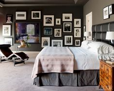 The collection of photographs in the master bedroom includes works by Ruven Afanador, Eadweard Muybridge, Chuck Close, and Helmut Newton; an Eileen Gray side table stands beside a vintage Le Corbusier chaise longue, and the custom-made leather headboard is fitted with sconces by Hinson & Co.