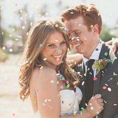 A Palm Springs wedding with lots of personal DIY touches and a gorgeous streamer backdrop!