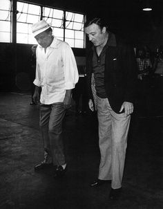 Gene Kelly and Frank SInatra. Still trying to teach Frank to dance?