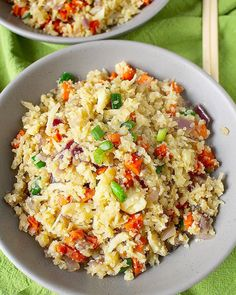 Paleo Fried Cauliflower Rice 1 large onion, diced 1 1/2 cup carrots, diced 2 tablespoons coconut oil 1 teaspoon salt 1- 1 1/2 teaspoons ground ginger (we prefer more, but adjust to taste) 1 teaspoon garlic powder 1 large cauliflower, grated 1/2 cup coconut aminos 2 eggs, scrambled 1/2 cup diced green onions