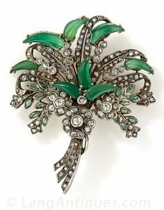 Antique Chrysoprase and Diamond Brooch. A unique and strikingly beautiful bouquet brooch, intricately hand crafted in silver over gold and glittering with 1.50 carats of old mine and rose-cut diamonds, accented with tiny emeralds and highlighting translucent, glowing green, jade-like leaves which are actually carved from natural green chrysoprase. Obscured European hallmarks on the pin stem, circa late-nineteenth century.