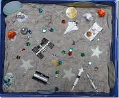 Space sensory tub ~ using moon sand. From http://totallytots.blogspot.com