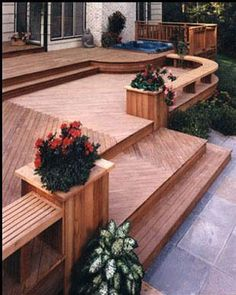 beautiful deck - wide step and built-in planters with bench seats. Plus a hot tub!
