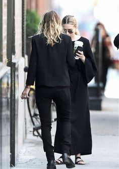 the Olsens in all black.