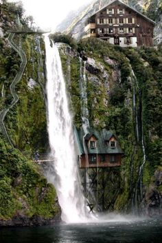 wooden houses and waterfall