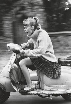 That's what I call living :). Woman riding scooter  photo by Jean-François Jonvelle  1984