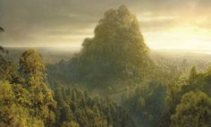 Caras Galadhon - the capital city of Lórien, at the center of the whole forest. In the Naith of Lórien, the heart of the Silvan Elven realm, it was built in the middle of, on top of, and out of the Mallorn trees that Galadriel had brought with her from Valinor, & was thenceforth the residence of Celeborn & Galadriel.