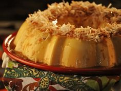 Coconut Flan with Dulce de Leche Recipe : Marcela Valladolid : Food Network Coconut Flan, Toasted Coconut, Coconut Milk, Köstliche Desserts, Delicious Desserts, Dessert Recipes, Mexican Made Easy, Chocoflan Recipe, Chocolates