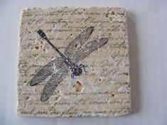 Dragonfly Travertine Tile Coasters. Olive green french script background with black dragonfly.
