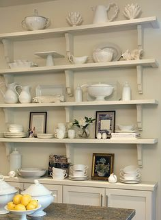 Wall shelving display of white dishes is just and useful.Very small depth of the base for a small kitchen design decorating interior design design Dish Display, Display Shelves, Wall Shelves, White Shelves, Hutch Display, White Bookshelves, Book Shelves, Bookcases, Display Ideas