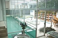 I ran into an article about the house with the interior clear-glass swimming pool, but I somehow lost it. Thankfully, I've found the house again!    Face it. You need an interior clear-glass swimming pool.