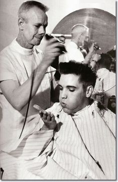 #Elvis Presley blows a strand of hair from his hand, while receiving a haircut from a US Army barber, Fort Chaffee, Arkansas.... every year they have a benefit haircutting in the same barber shop (and chair) where Elvis got those locks cut off. The son of the barber in this photo is actually the barber for the event.