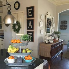 Use A Fruit Stand To Display More Than Just It Greenery And Small Home Decor Items