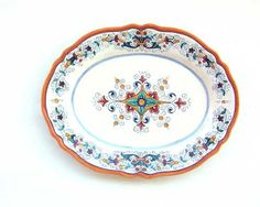 """OVAL SERVING PLATTER WITH SCALLOPED EDGE: DERUTA: 13"""" (33cm) Long.    This 16th century pattern is made up of scrolled floral elements from the borders of Renaissance plates divided into sections. The design comes from frescoes by Perugino at the Collegio del Cambio in Perugia. This pattern is important because we see the first use of yellow, orange, and blue. Previously only green and brown were used.    This Piece is hand painted in Deruta.  #Deruta #Gubbio #Tuscany #Italy #Ceramics"""