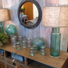 I just love the whole picture... But glass bottle lamps?? Yes please!