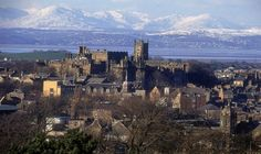 Lancaster Town Centre and Castle with Lake District Mountains with Snow on them.  Lancaster Lanashire England