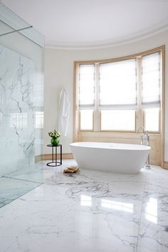 In this cavernous bathroom decoration has been kept to a minimum, to create a serene space.
