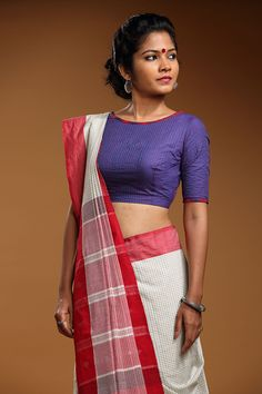 Red quilting on an ink blue blouse with a button down back. An outfit for a muse.   THE KAITHARI PROJECT   Pioneer Women Collection   Handwoven, designed and...