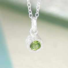 A stunningly simple and elegant pendant featuring a single peridot semi precious stone in a naturally textured sterling silver setting. #Embersjewellery #Jewellery#accessories #giftforher #Peridot