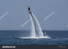 Camyuva, Kemer, Turkey - July 12, 2015: Unidentified Turkish Man Hovered Above The Water. Extreme Water Sports Are Increasingly Popular On The Beaches Of Turkey Стоковые фотографии 396448336 : Shutterstock