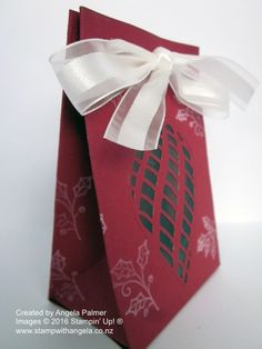 A Christmas Gift Bag made using the Gift Bag Punch Board and featuring the Embellished Ornaments stamp set.  The window is made with the Delicate Ornament Thinlits Dies. (Side view)