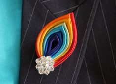 Hey, I found this really awesome Etsy listing at http://www.etsy.com/listing/121544040/rainbow-kanzashi-brooch-pin-or-multi