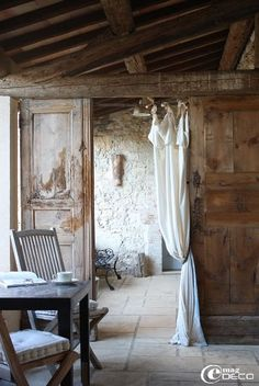rustic wood and draped white linen
