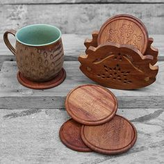 Elegant Set of 6 Hand Carved Wooden Drink Coasters (8 cm) in a Holder with Brass Inlay Store Indya http://www.amazon.in/dp/B01DM1U8JG/ref=cm_sw_r_pi_dp_tLDdxb19GTPV8