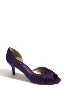 Bridesmaid Shoes. Love the idea of red dresses/purple shoes and you in red shoes. These come in red, too, and aren't too high.