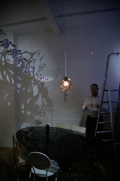 Maybe we could work with light and shadow. Project something on a textured wall. Garland, Lighting, Studio Tord Boontje