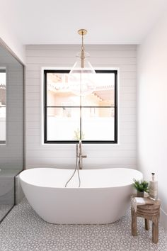 Ah...what a tranquil space, featuring the Hudson Valley Ivy pendant by Becki Owens...  Design by Becki Owens, Photo by Rebekah Westover  #BathLightingIdeas #BathroomRemodel #BathroomIdeas #PendantLighting