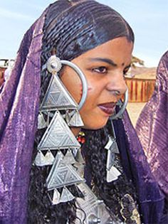 *|*  Tuareg Woman.  The Tuareg prefer silver, the metal of the Prophet, to gold which is considered impure.