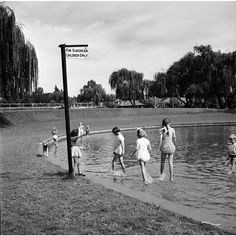 """Signs of Apartheid What South Africans had to look at every day for four decades.  1956 White children paddling in a pond marked by a sign reading """"For European Children Only."""" IMAGE: THREE LIONS/GETTY IMAGES #photography #southafrica #apartheid (via @mashable)"""