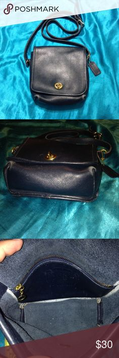 Coach Companion (9076) This little vintage piece is very timeless and can complete any look. The color is navy blue. Inside is very clean and almost spotless. There are signs of wear such as color fading on the bottom corners, minor scratches, and a small white stain on the back (see pic 4). Strap is adjustable and in good shape. Hang tag is still attached. Overall condition is good and I rate it 7/10. Dimensions: 7x7x3 inches. I don't trade or accept lowball offers. Coach Bags Crossbody…