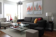 Living Room Black Loveseat With Red Sofa Cushion Also Grey Accent Chair And Desk Lamp Besides Carpet Pendant Red Vase Glass Window Painting Wooden Floor How to Make Masculine Interior for Male Living Room on a Budget