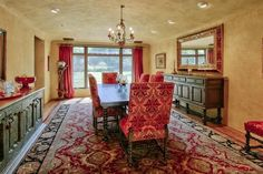 The red decor takes this dining room to the next level. Los Ranchos De Abq, NM Coldwell Banker Legacy