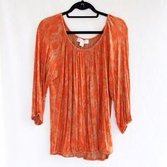 MICHAEL Michael Kors Orange Peasant Blouse This beautiful burnt orange blouse is extremely comfortable. Elastic on neckline, sleeves, and hem. Loose fitted. Great condition! 95% Rayon and 5% Spandex. MICHAEL Michael Kors Tops Blouses