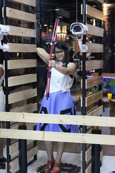 She is just pretending to do archery. Becaue look at her afterall, she's too pretty to be holding that thing! But she rocks the hexagon skirt to the T.