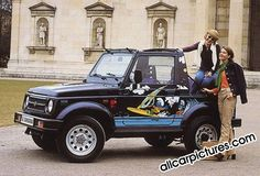 Suzuki Samurai with surfing smurfs.