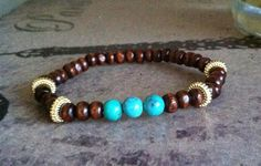 Handmade Semiprecious Turquoise and Wooden Elastic Beaded Bracelet with Gold Plated Separators on Etsy, $18.00