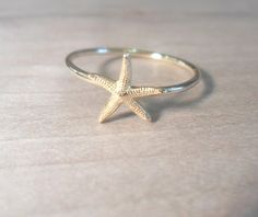 Starfish Knuckle Ring-Layering Above the Knuckle Ring Gold Brass Stackable Midi Ring-Starfish ring by AWildViolet on Etsy https://www.etsy.com/listing/157774496/starfish-knuckle-ring-layering-above-the