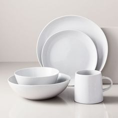 Created by designer Aaron Probyn, light speckling peeks through a crackle glaze on this dinnerware collection. A refined shape elevates the rustic finish, for dinnerware you'll want to use morning, noon and night. Stoneware Dinnerware Sets, White Dinnerware, Porcelain Dinnerware, Tableware, Modern Dinnerware, Kitchenware, Farmhouse Dinnerware, Dinner Plate Sets, Dinner Plates