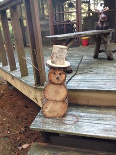 Snowman made from logs and pin cones from woods, made by mike.